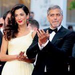 George e Amal Clooney em marcha por controle de armas em Washington